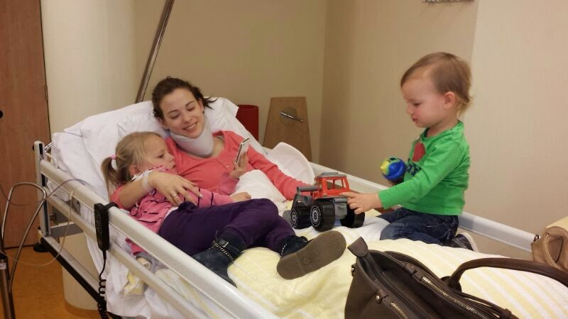 Her children visiting her in the hospital
