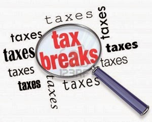Tax Breaks graphics under a magnifying glass