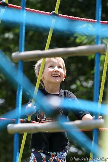 Alec Stanton-Croom, 4, Clive, on a climbing frame at the Lions' Community Park in Sylvan Rd, Hastings, in pleasantly hot sunny weather. photograph