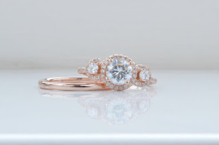 rose gold and moissanite engagement ring