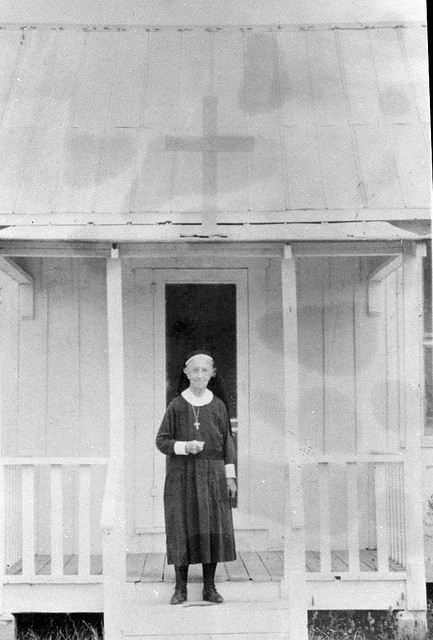 Deaconess Bedell on the porch of the Mission of Our Savior : Collier City, Florida,  between 1933 and 1960