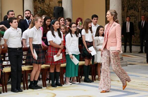 Infanta Elena of Spain wore Boss pumps and Mango pink jacket and Zara print trousers carried Mango clutch