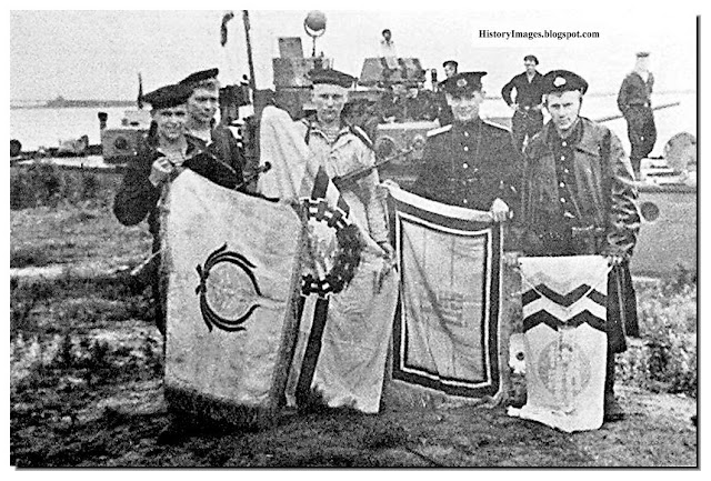 Russian sailors with captured Japanese flags