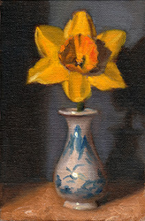 Oil painting of a yellow and orange daffodil in a miniature blue and white porcelain vase.
