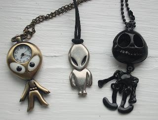 three alien pendant necklaces