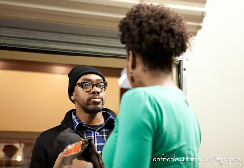 director laron austin talks to his make up and hair supervisor jenique on the next scene - Christmas Bounty Cast