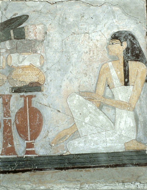 Woman Kneeling Before an Offering Table