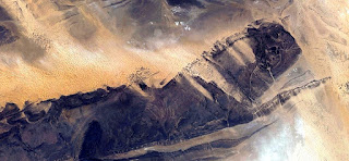 abstract surrealism, photographs deserts of Africa from the air,