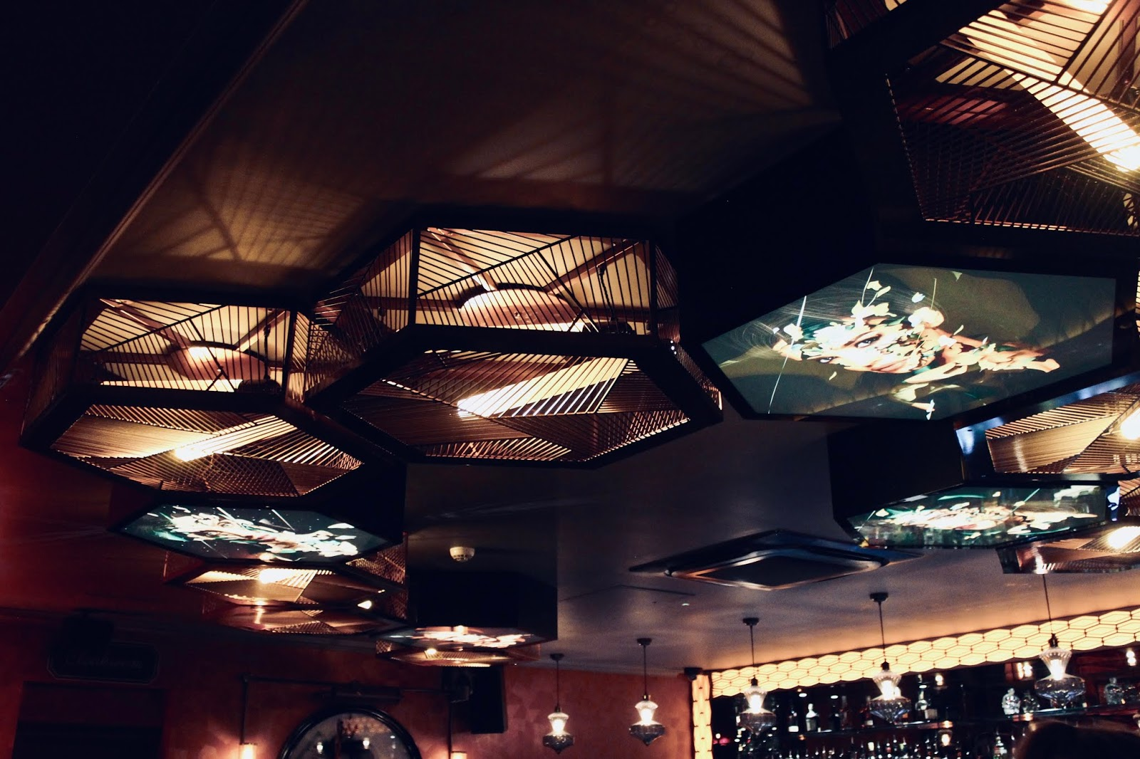 Ceiling with lights on in dirty martini