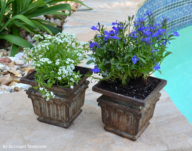 garden planters made from rusty old cast iron post bases