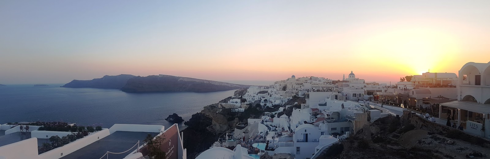 Sunset at Oia Santorini - how to travel in Santorini on a budget itinerary