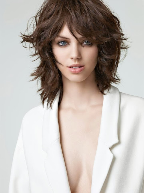medium length hair cut with layers, texture and bangs