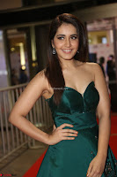 Raashi Khanna in Dark Green Sleeveless Strapless Deep neck Gown at 64th Jio Filmfare Awards South ~  Exclusive 096.JPG