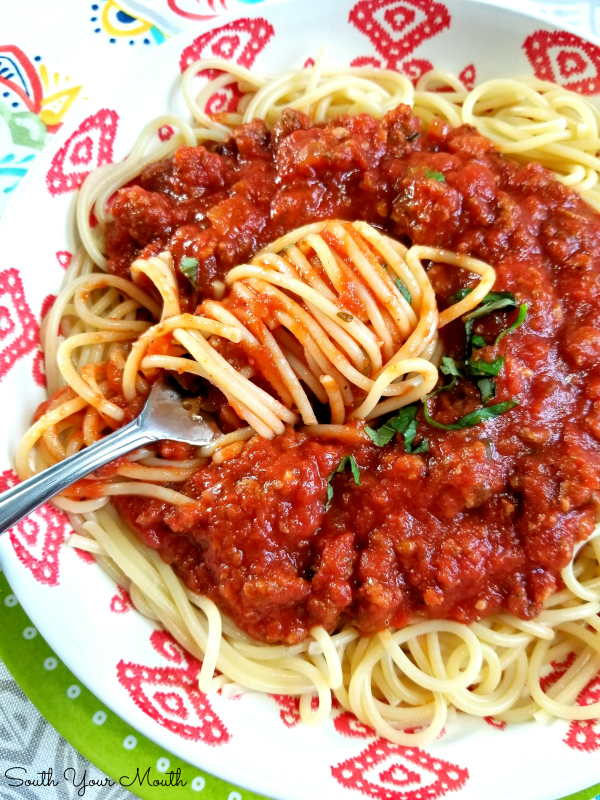 Homemade Spaghetti with Meat Sauce | A hearty classic Italian pasta sauce recipe made from scratch with sausage and ground beef. Easily cut this BIG BATCH recipe in half or make a whole pot for feeding a crowd or stocking your freezer with an easy weeknight meal.