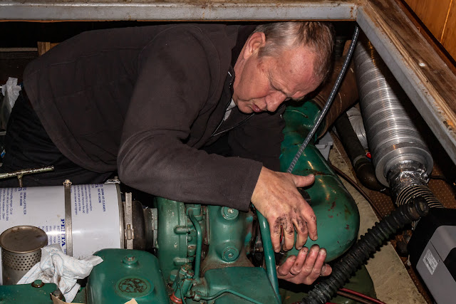 Photo of Phil refitting the exhaust elbow on Ravensdale's port engine