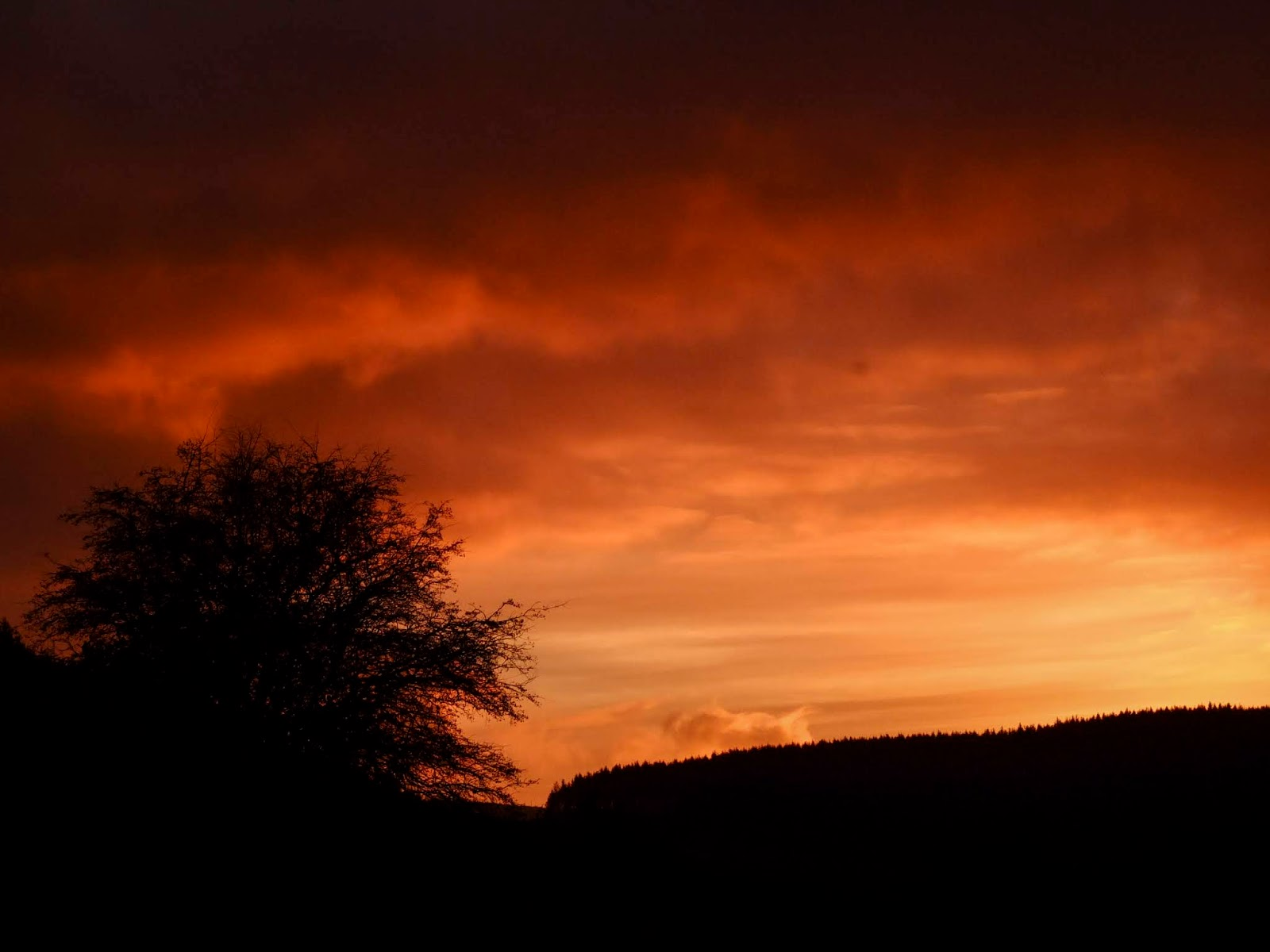 An orange sunset sky in the mountains in North Cork.