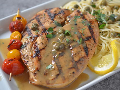 Grilled chicken piccata with fire grilled tomatoes