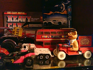 A small of selection of old toys, including a double decker bus and Fozzie Bear.