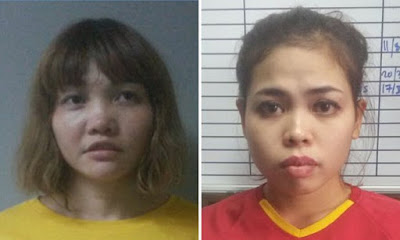 Vietnamese Doan Thi Huong (left) and Indonesian Siti Aisyah