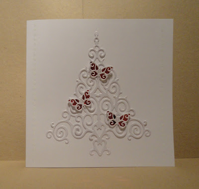 White Christmas card, swirly tree with three white and red butterflies