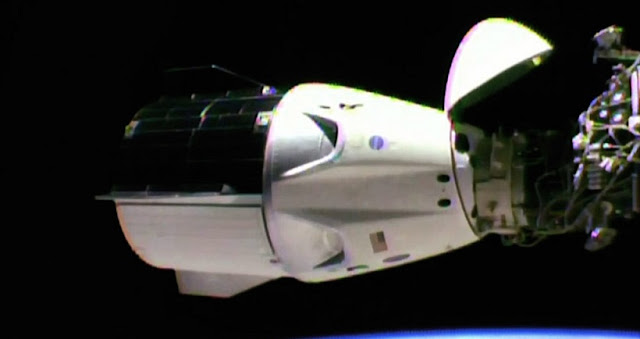 The SpaceX Crew Dragon is docked to the station's international docking adapter which is attached to the forward end of the Harmony module. Credit: NASA TV
