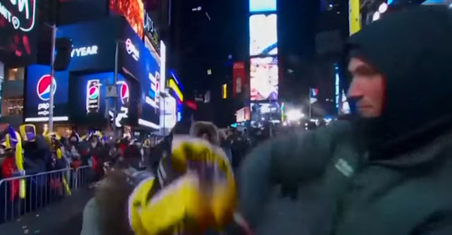 New Years Eve 2018 New york Time Square dancing purple yellow hat falling off
