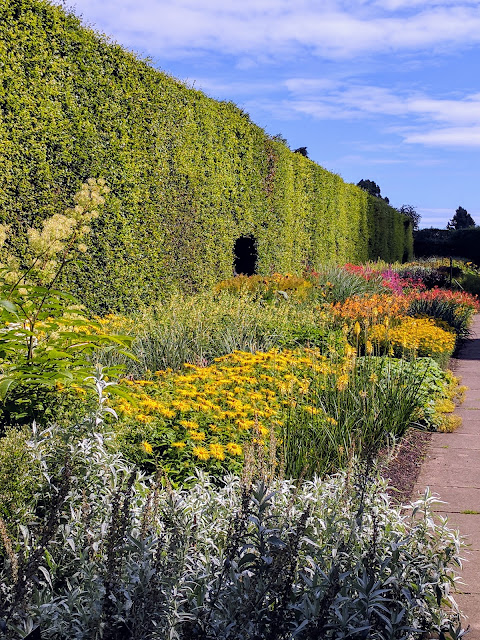 Garden walled by a giant hedge at the Royal Botanic Garden Edinburgh