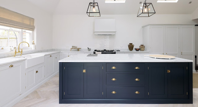 Minimal modern farmhouse kitchen with Shaker cabinets, high ceilings and modern lighting - found on Hello Lovely Studio