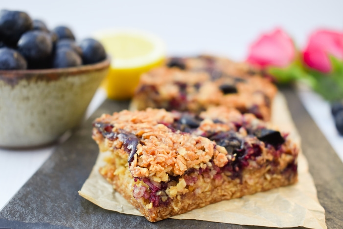 Close up of blueberry and lemon oaty breakfast bars