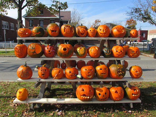 halloween pumpkins displayed on a bench