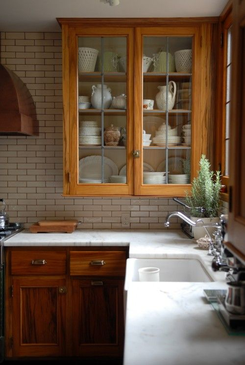 Love this vintage style kitchen with wood cabinets! Lots more great examples on this site. Postcards from the Ridge