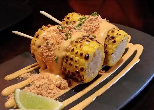 The Black Toro: corn on the cob with chipotle mayonnaise, ground masa and lime