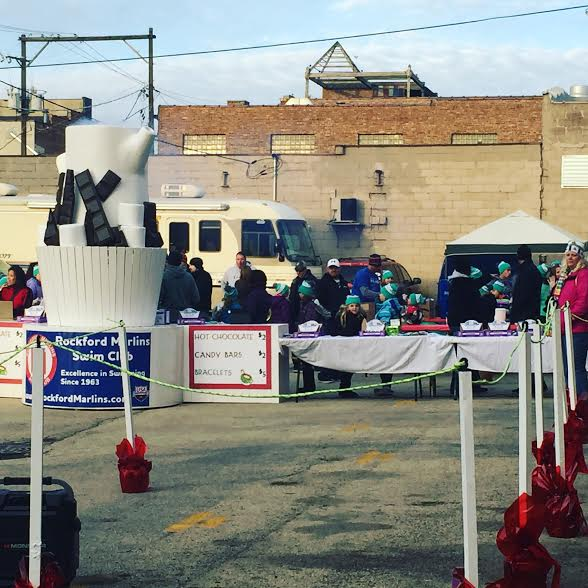 Hot Chocolate Express provides crowds with a holiday favorite during Stroll on State in Rockford, IL.
