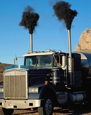 Thick black smoke being emitted by a vehicle