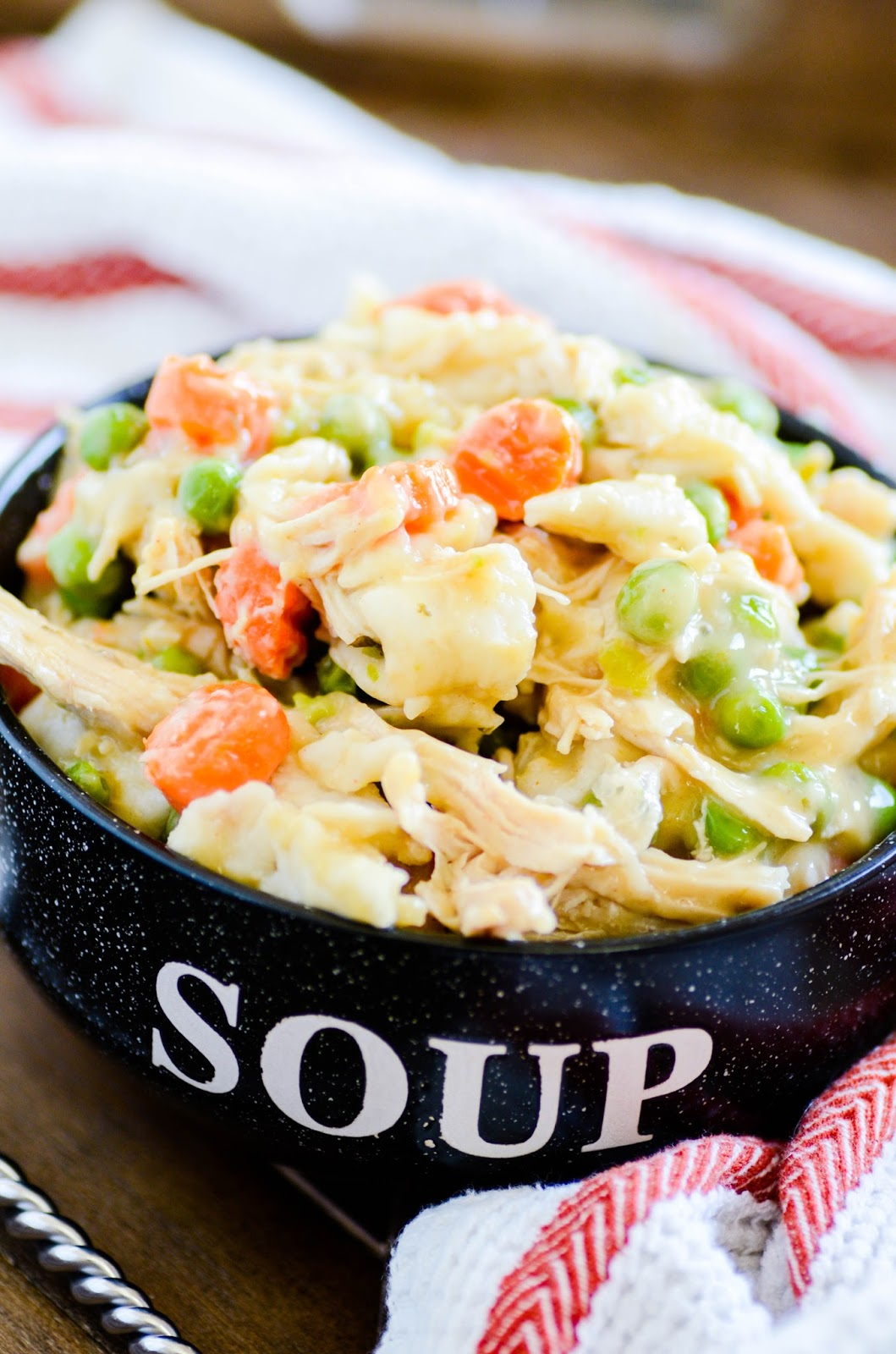 A quick and easy weeknight dinner of chicken and dumplings that the whole family will love.