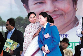 Mamata congratulates a winner of a sports event in Kurseong