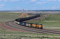 A coal train in the Powder River Basin. (Credit: Huddleston/Flickr) Click to Enlarge.