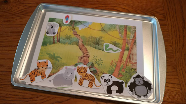 Magnetic animals and matching scene on baking sheet