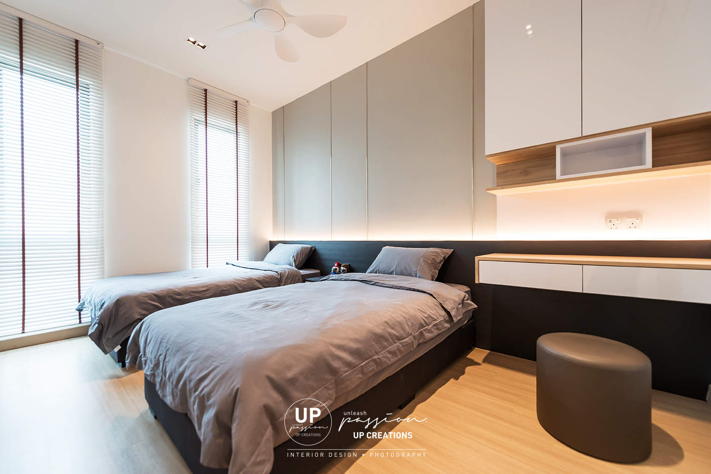 trinity aquata condo guest room with two single beds, bedhead in light grey paint finish and stainless steel inlay and led strip light