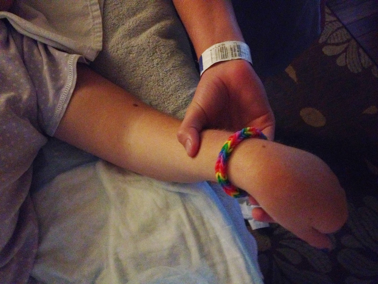 Ruby showing off the handmade bracelet she made for her sister as a gift.