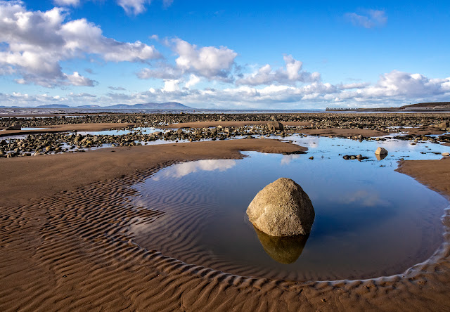 Photo of an attractive pool on the shore at Maryport at low tide