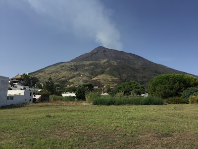 View of Stromboli volcano the morning of the hike. Note the cane grass on the lower to mid levels of slope - same area as in left photo.
