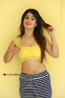 Cute Telugu Actress Shunaya Solanki High Definition Spicy Pos in Yellow Top and Skirt  0515.JPG