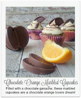 Chocolate Orange Marbled Cupcakes Recipe.  Made with a marbled Victoria sponge, filled with a chocolate orange ganache & topped with a vanilla frosting, a chocolate orange segment and drizzle, these cupcakes are perfect if you're looking for something a little bit special in a cupcake form.