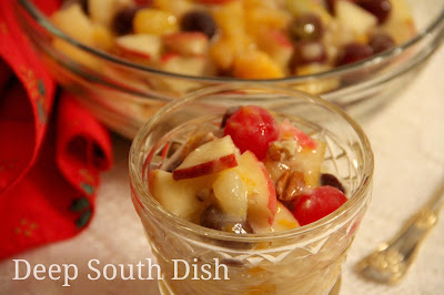 Old Fashioned Holiday Fruit Salad with Custard Sauce - a mixed fruit salad, made with canned fruit cocktail, mandarin oranges, grapes, maraschino cherries and fresh apples and finished with an egg custard and fruit juice based dressing - a long-time favorite on many Southern holiday tables.