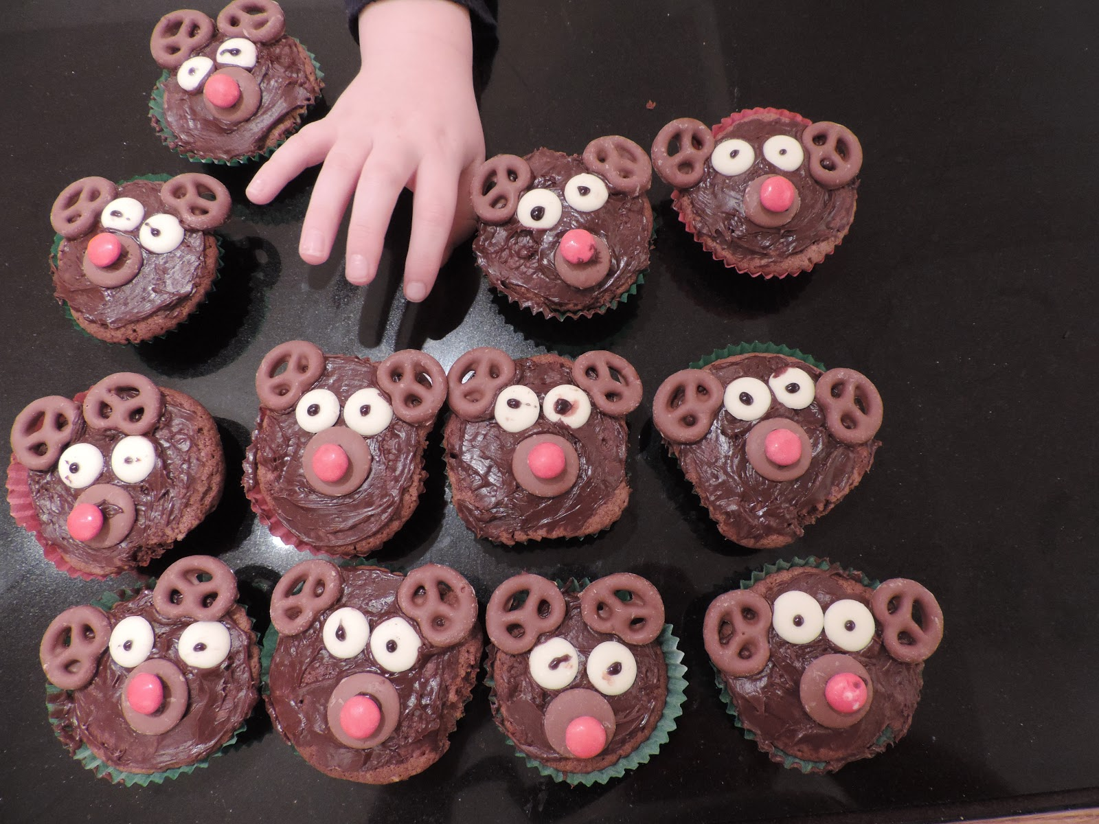 cup cakes with reindeer faces pretzel ears
