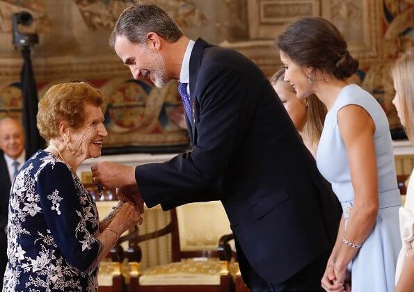 King Felipe, Princess Leonor and Infanta Sofia. Queen Letizia, blue dress, diamond bracelet, and diamond earrings