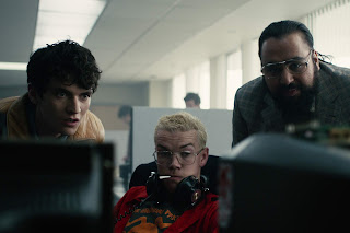 """Bandersnatch"" Black Mirror - Stefan, Collin, and their boss peer at a computer screen."