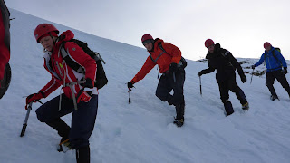 Learning to use ice axe and crampons on Cairngorm winter skills course