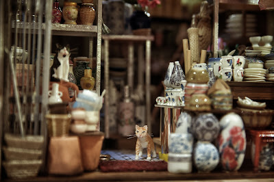 Detail of a modern dolls' house miniature Hong Kong ceramics shop.